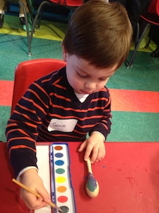 Gavin painting a maraca from the March themed BabbaBox at Barefoot Books.