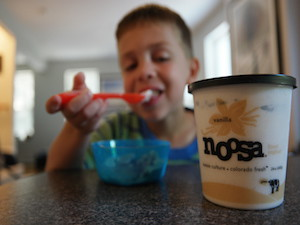 boy eating vanilla Noosa Yoghurt